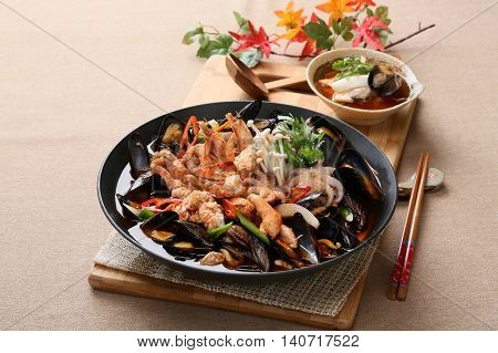 Cool and spicy seafood soup taste with octopus clams mussels and shrimps