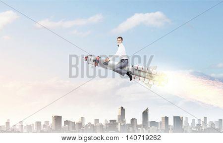 Man riding missile . Mixed media