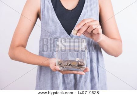 hands holding piggy bank show money coin in piggy bank on white background. business savings finance concept