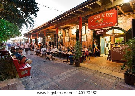 KEY WEST FLORIDA USA - MAY 03 2016: Tourists are eating and relaxing at a restaurant near Mallory Square in Key West in Florida.