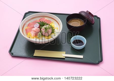 Tray meal of Japanese style with rice sushi and soy sauces