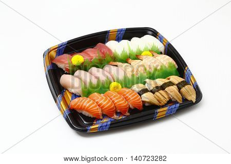 Sushi tray with fresh shrimps tuna salmon squid and fish on white background