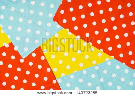 Colorful polka dot napkins pattern. Background from multi-colored textile napkins with polka dots. Red sky blue and yellow napkins.