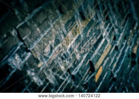 blury stone wall with waterfall dark tone color