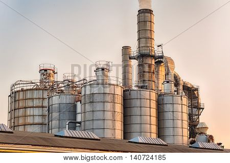 Chimneys And Silos Of A Factory.