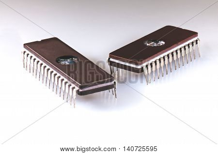 Two EPROM integrated circuit chips arranged on a white background