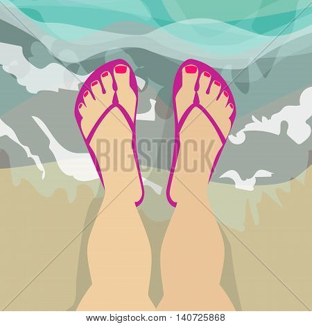 Female feet in shales standing in sea water Caucasian