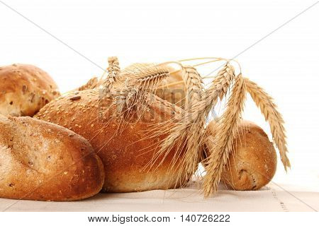 Close-up Bread and ears with grains. Isolate