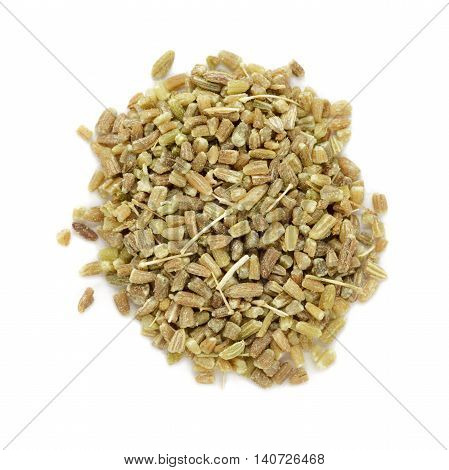 Organic fennel (Foeniculum vulgare) in tea cut size. Isolated on white background. Macro close up. Top view.