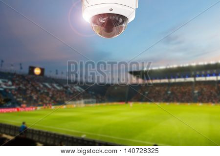 CCTV camera stadium football twilight on background.