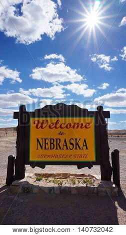Welcome to Nebraska road sign with blue sky