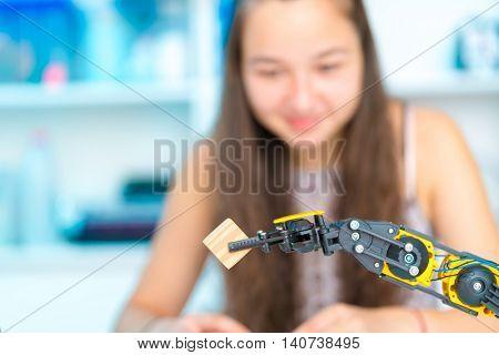 Teen girl in robotics laboratory