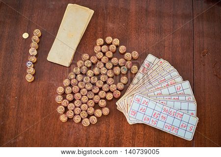 Vintage lotto: kegs and cards. Placed on a wooden table