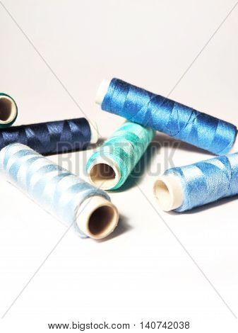 Sewing material, isolated on White background. Sewing bobbins.