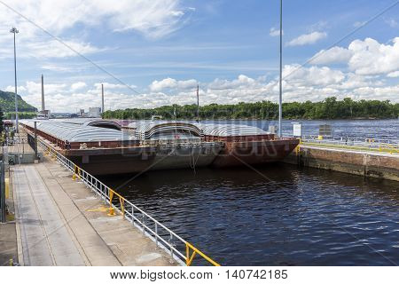 A barge entering a lock and dam.