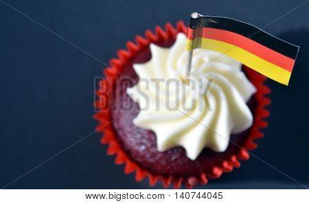 German National Day cupcake with german (black red and yellow) flag. The Day of German Unity. Focus on the flag.