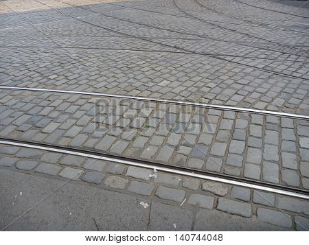 Tram Line Crossing On Cobble Stones Road