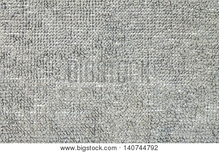 Closeup surface fabric pattern at the gray fabric mat at the floor of house texture background