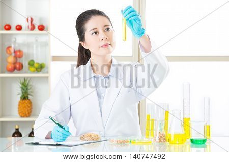 Scientist Recording On Clipboard Of Gmo Food