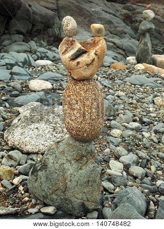 Balancing stone art on a shingle beach