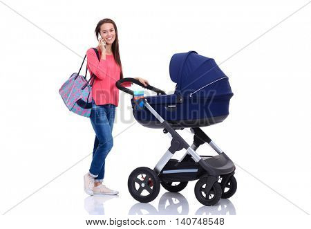 Full length portrait of a mother with a stroller talking on the phone, isolated on white background