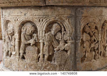Ancient medieval sculpted crafts stone water well in Roc de Sant Gaieta Tarragona Spain.