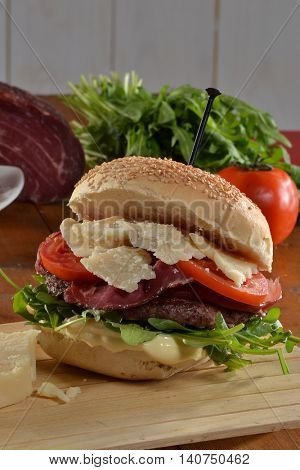 Hamburger with parmigano cheese and ingredients.