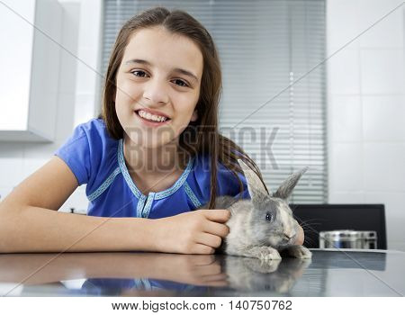 Smiling Cute Girl With Rabbit In Hospital