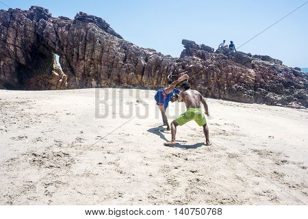 Jericoacoara Ceara state Brazil - July 19 2016: Brazilian capoeiristas performing at the famous Pedra Furada Beach