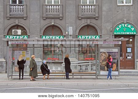 Warsaw, Poland - October 24, 2015: people are waiting for a bus at stop in Warsaw, Poland