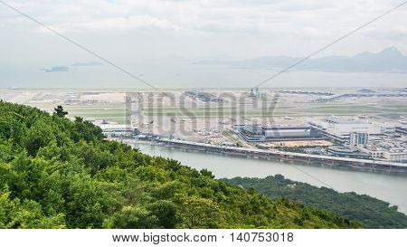 HONG KONG - MAY 26: A view of Chek Lap Kok Hong Kong International Airport from the Ngong Ping 360 cable car on May 26 2016 in Hong Kong.