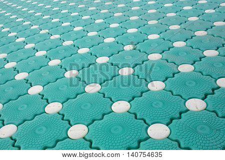 Closeup Pontoon green and white dot background texture