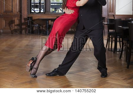 Low Section Of Dancer Leaning On Partner While Performing Tango