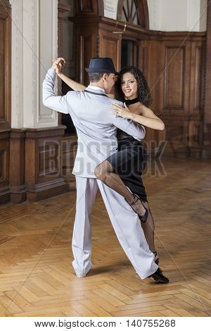 Smiling Woman Performing With Male Tango Dancer
