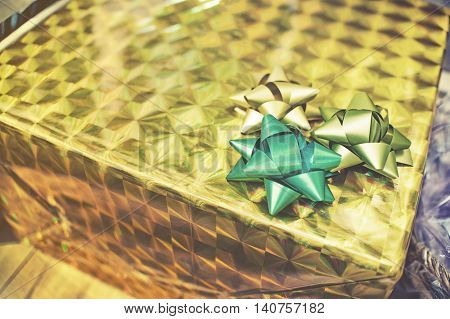 close up on Packed glittery gold present container