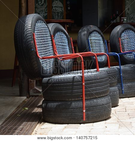 OMBIKA NAMIBIA - FEB 03 2016: Chairs made from used car tires. An example of a non-standard design from recycled materials