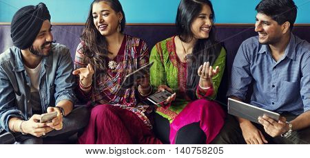 Indian Friends Hangout Indoors Technology Concept