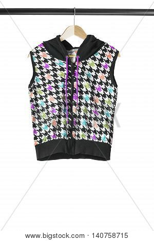 Colorful sport vest on wooden clothes rack isolated over white