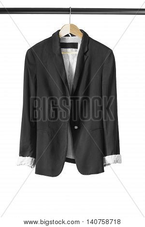 Black formal jacket on wooden clothes rack isolated over white