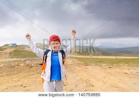 Happy Little Boy In Red Cap
