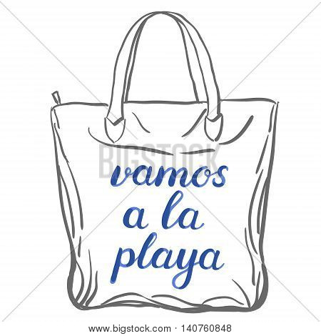 Vamos a la playa. Let s go to the beach in Spanish. Brush hand lettering on a sample tote bag. Great for beach tote bags, swimwear, holiday clothes, and more.