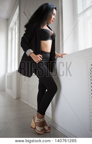 Young Brunette In Black Clothes