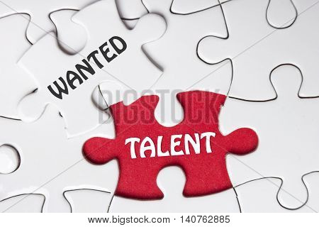 HIRING concept. Missing Piece Jigsaw Puzzle with word Talent Wanted.