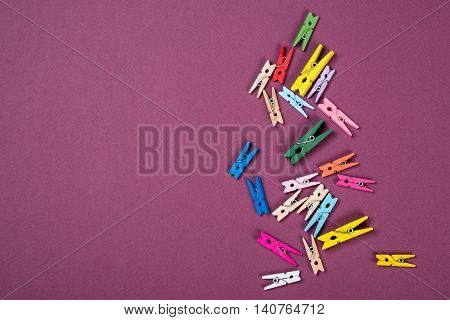 A lot of the colorful clothes pegs for scrapbooking design or decor.