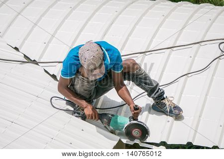 Workers are saw a roof on the roof