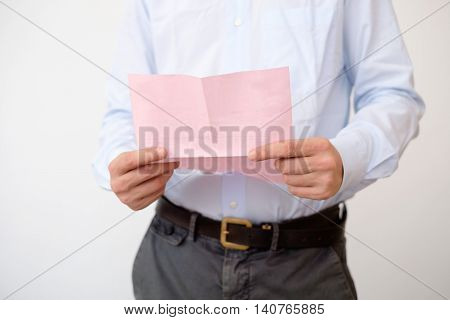 Business man reads the notice of job termination