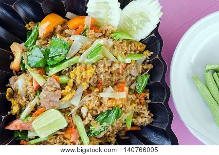 Tomato With Fried Rice And Vegetables