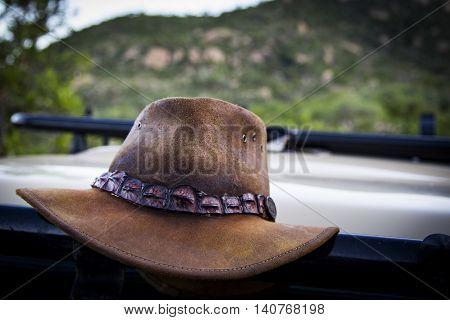 cowboy hat lying around on a car