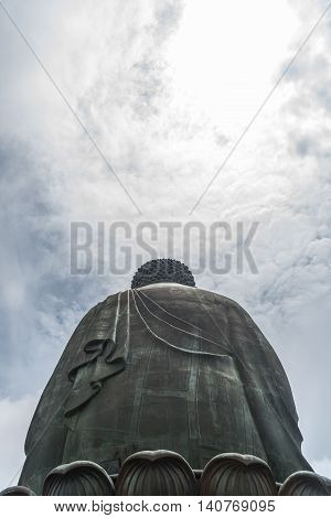Tian Tan Buddha' back and bright blue sky with white cloud in sunny day in Hong Kong.
