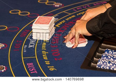 black jack table, mixing cards for gambling